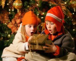 Children looking inside Christmas present