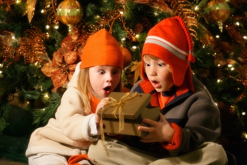 Children looking inside Christmas present